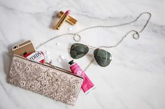 Everything you need at your fingertips! What are your big day clutch essentials? (link in profile to shop) by bhldn