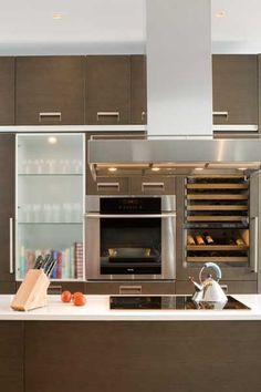 Induction stovetop on the center island, and wine cooler on the wall.  That's a good thought.