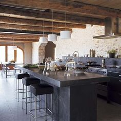love concrete counters, modern lighting with the warmth of rustic walls & timber ceiling.