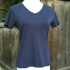"Lands' End Petite Navy V-Neck Tee Worn a handful of times, a basic navy t-shirt. So comfy, perfect for layering or wear with a cute pair of shorts! 100% cotton. Pit to pit: 18"", shoulder to shoulder: 14.5"", length: 22"". Lands' End Tops Tees - Short Sleeve"