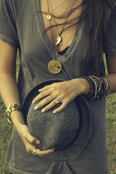 love all the accessories with the plain gray v-neck.