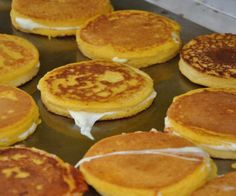 """Corn Pancake Sandwiches """"Arepas de Choclo"""" on BigOven: The traditional arepa served in Miami has two cornmeal pancakes with a layer of cheese inside. Anything to do with cornmeal pancakes, I'm in. Corn Pancakes, Cornmeal Pancakes, Colombian Food, Colombian Arepas, Colombian Recipes, Colombian Cities, Venezuelan Food, Good Food, Yummy Food"""