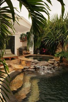 Small Naturalistic Hot Tub With Small Waterfall Into Pool.
