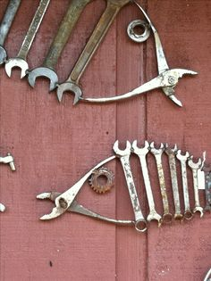 "Repurpose! Someone repurposed old tools to make ""fish"" of different sizes as wall art work."