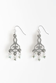 Small Filigree Acrylic Earrings- Filigree pattern is delicately cut from silver coloured acrylic which hangs from a sterling silver filled ear hook. Iridescent green glass beads dangle from the bottoms of these bold earrings. Filigree, Jewelry Collection, Glass Beads, Dangles, Drop Earrings, Sterling Silver, Unique Jewelry, Iridescent, Handmade Gifts
