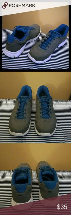 Nike Revolution 2 Grey, blue, and white Nikes. Size 10.5 Good condition but have been worn. Nike Shoes Sneakers