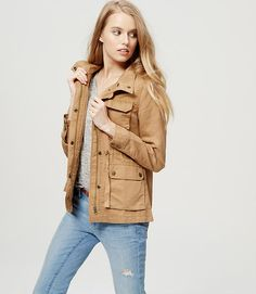 """Made in luxe linen cotton twill, we're into the wayfaring vibe of this pocketed piece. Drawstring funnel neck. Long sleeves. Zip front with snap closures. Flap chest pockets. Button flap patch pockets and cuffs. Drawstring waist. Back yoke. 26 1/4"""" long."""
