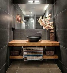 Beautiful bathroom. Love! Wooden vanity. Large grey tiles.