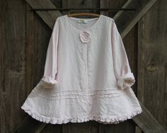 linen top flare with ruffle, tucking and a rose in light pink ready to ship