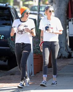 The 26-year-old rocked a pair of grey skinny turn-ups and trainers, with a white graphic S...