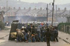Ireland The Troubles. Belfast hijacked lorry set on fire by young IRA trouble makers and used as a barricade in petrol bomb fight against th...