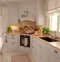 Wood countertops add roughness in a modern farmhouse kitchen to balance out more., Wood countertops add roughness in a modern farmhouse kitchen to balance out more. Narrow Kitchen, Kitchen Corner, New Kitchen, Vintage Kitchen, Kitchen Dining, Kitchen Decor, Kitchen Cabinets, Corner Stove, Kitchen Wood