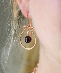 Garnet and Copper hoop earrings.