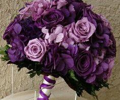 Deep purple hydrangeas and lavender roses