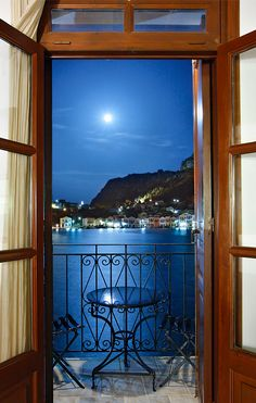 "♪ Moonlight Serenade ♪  ~ picturesque harbor of Kastellorizo (or ""Meghisti"") island under a full moon. Kastellorizo is one of the most beautiful Greek islands."