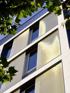 SEFAR Vision Fabric Interlayer for Glass Curtain wall and Façade Design.  Gold Textile Mesh reduces Solar Gain and Glare