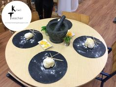 Play dough provocation with a morton and pestle. Love the use of black place mats.