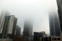 Melbourne high rise buildings disappear into fog