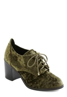 I wish I could afford these lovelies. Something about an olive velvet shoe tickles my inner librarian.