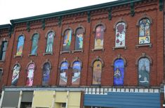 Boarded up windows turned into art