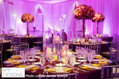 This wedding reception is so gorgeous! The purple lighting and centerpieces make a fabulous scenery. #unique @janaeshields