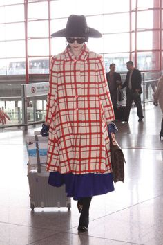 A statement coat at the airport? Why not?