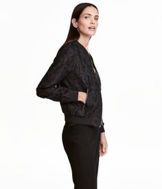 Black. Jacket in woven, patterned fabric. Small stand-up collar, zip at front, side pockets with zip, and ribbing at cuffs and hem. Lined.