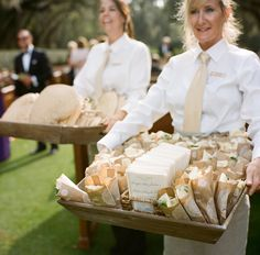 Pastry bag filled with white rose petals to throw at newlyweds walking down the aisle.  Photo by A Bryan Photo.