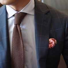 blue window pane suit. light gray pinstriped oxford. brown knit tie. pink paisley pocket square. sleek. dapper. trend. style.