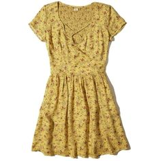 Hollister Strappy Front Smocked Dress (970 CZK) ❤ liked on Polyvore featuring dresses, yellow floral, floral fit-and-flare dresses, floral print dress, flower print dress, fit flare dress and floral dresses