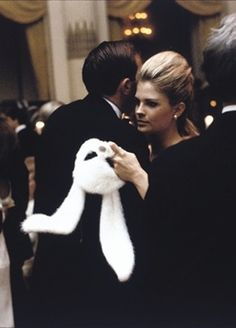 Candice Bergen at Truman Capote's Black and White Ball, New York, 1966. Bergen later admitted that she was bored, but she needn't have - her expression said it all! BTW, her furry rabbit mask was designed by Halston. KA