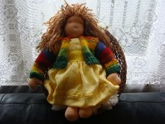 I also made this Waldorf doll in her party dress with rainbow cardigan.
