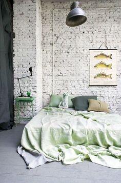 dream space-- bricks, high ceilings, big metal light fixture, big wide bed.