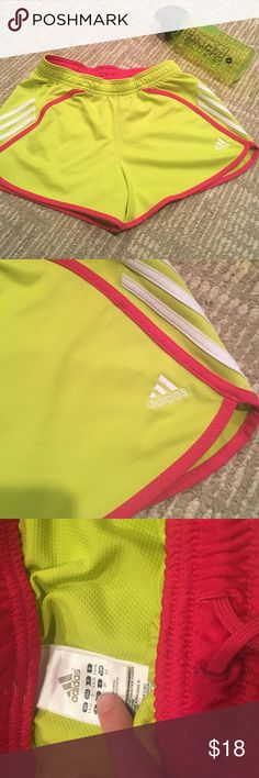NWOT ADIDAS RUNNING SHORTS NWOT brand new adidas running shorts a bright and vibrant yellow / green color with hot pink drawstrings has elastic waistband super stretching comfy and cozy smoke free home fast shipping! Follow for deals ! Adidas Shorts