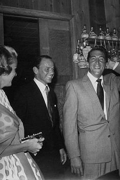 Frank Sinatra and Dean Martin at Sinatra's 42nd birthday party held at the Villa Capri, 1957.
