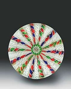 Antique Saint Louis three color crown with 28 twisted spokes of alternating red/blue, red/green, and white latticinio, with a complex cane at the top. Circa 1845-55. Diameter 3-¼ inches.