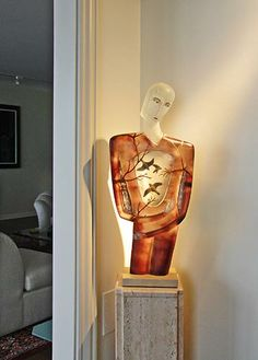 Habitat by Robin Grebe is in the study, just off the living room. Cast glass with wooden inserts.