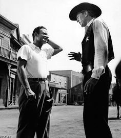 HIGH NOON (1952) - Gary Cooper (pictured) - Thomas Mitchell - Lloyd Bridges - Katy Jurado - Grace Kelly - Otto Kruger - Produced by Stanley Kramer - Directed by Fred Zinneman (pictured) - United Artists - Publicity Still.