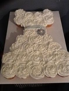 Bridal shower pull-apart cupcake cake.  This would be cute in pink for a Sweet Sixteen too!