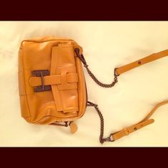 Halston Heritage leather bag Very cute mustard colored shoulder or cross body bag. Works for all seasons! Small but holds everything. Halston Heritage Bags Shoulder Bags