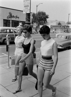 "The shortest of the 1950s shorts were ""short shorts."" These came to about 6 inches above the knee and had classic 1950's high waists and side zippers. These shorts were mostly worn on the beaches, or on pin up models. Another name for these shorts is culottes. Culottes could be short or a bit longer and have wide leg openings that flair out from a tight waist and hip."