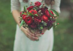 The deep red of the ranunculus against the pure white flowers, coupled with the blue of the privet berries make this a sublime winter bridal bouquet. We are so in love! Credit goes to the talented Beargrass Gardens Floral And Events located in Montana. Rebecca Hollis Photography created these gorgeous images. Take a look ~
