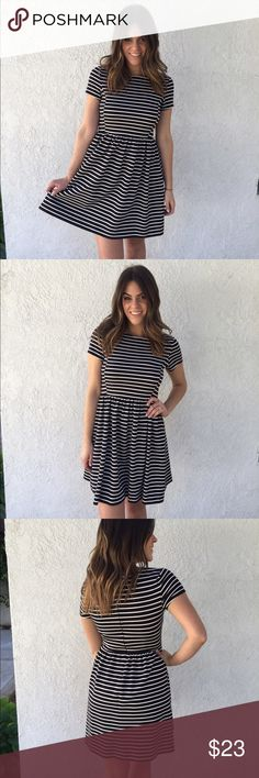 Black & White Striped Dress Black & white striped dress; zips up the back; 68% polyester, 30% rayon, & 2% spandex; worn once and in excellent condition! simple, classic & cute! Peter Som Dresses