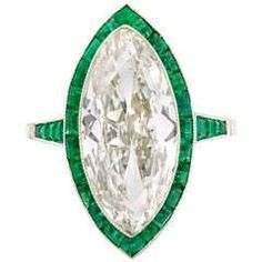 Edwardian Marquise Diamond Ring with Calibre Emerald Border   From a unique collection of vintage engagement rings at https://www.1stdibs.com/jewelry/rings/engagement-rings/