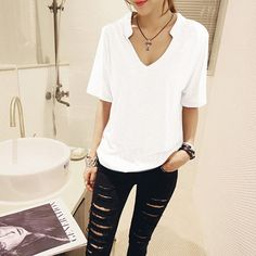 Vintage V-neck Shirt - Rebel Style Shop - This simple and stylish shirt is a wardrobe staple. Wear it with some shorts and sneakers for a laidback weekend look, or spice it up with sexy jeans and punk accessories. The short-sleeved shirt is made of cotton, and is available in three colors.