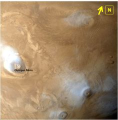 Olympus Mons is the largest volcano in the solar system which is present on planet Mars. The altitude of Olympus Mons is nearly three times the altitude of the largest peak on Earth, Mt.Everest.