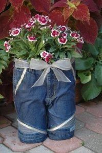 Take small girls jean cutoffs, fill leg with 2 ltr. bottles.  Cut top of bottles off at shoulder, and fill bottoms with plaster paris.  Use Stiffy Bow from craft store to brush on jeans for body.  Fill with dirt and plants.