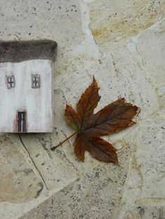 House of wood and cloth house with brown roof by BLUSTUDIOshop