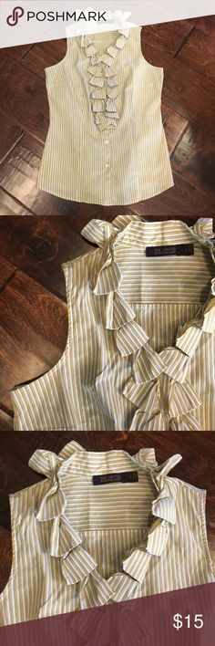 The Limited Essential Blouse Stripped gold and white with black pin stripe essential shirt. Beautiful twisted tie detail down the front.  Sleeveless and buttons down the front. Size small. Made 75% cotton, 22% nylon, and 3% Lycra.  No holes, stains, or tears.  Offers considered through offer button. The Limited Tops Button Down Shirts