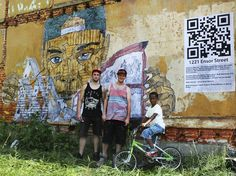 The mural is finished off with a giant QR code. When you snap a picture with a smartphone it takes you to Ott's Slumlord Watch website to find out who owns the building, and the politicians who represent the neighborhood.